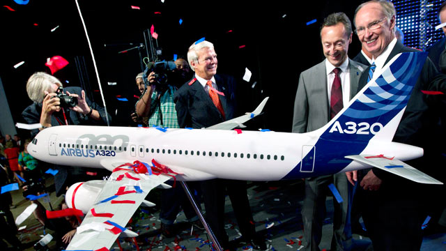 PHOTO: Alabama Gov. Robert Bentley, right, and Airbus President & CEO Fabrice Bregier celebrate the announcement that Airbus will establish its first assembly plant in the United States in Mobile, Ala., July 2, 2012.