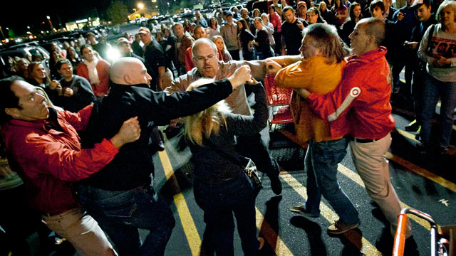 PHOTO: A crowd gathers as security guards break up a fight between shoppers waiting in line just as the doors open for Black Friday shopping at Target, Nov. 22, 2012, in Bowling Green, Ky.