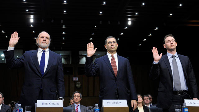 PHOTO: From left, Former MF Global Holdings Ltd. Chairman and CEO Jon Corzine, MF Global Holdings Ltd. President and COO Bradley Abelow, and MF Global Holdings Ltd. CFO Henri Steenkamp, are sworn in on Capitol Hill in Washington, Dec. 13, 2011, prior to