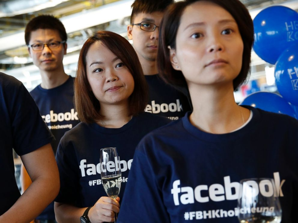 PHOTO: Facebook staff members attend the opening ceremony of their new office in Hong Kong, July 24, 2014.