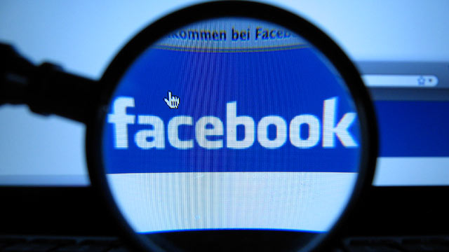 PHOTO: In this Oct. 10, 2011 file photo, a magnifying glass is posed over a monitor displaying a Facebook page in Munich.