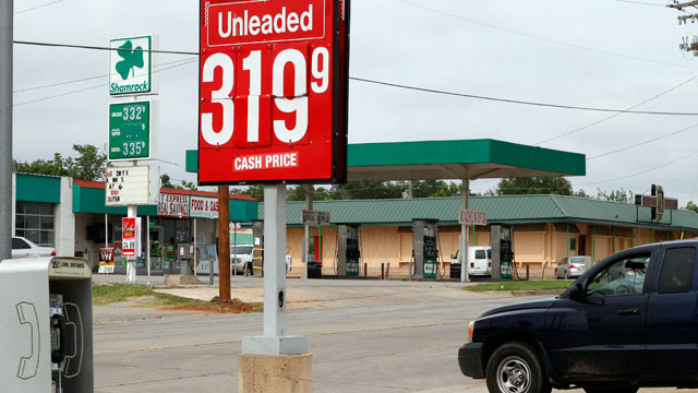 PHOTO: Competing gasoline stations advertise gas at 3.199 and 3.323 per gallon in Oklahoma City, June 21, 2012.