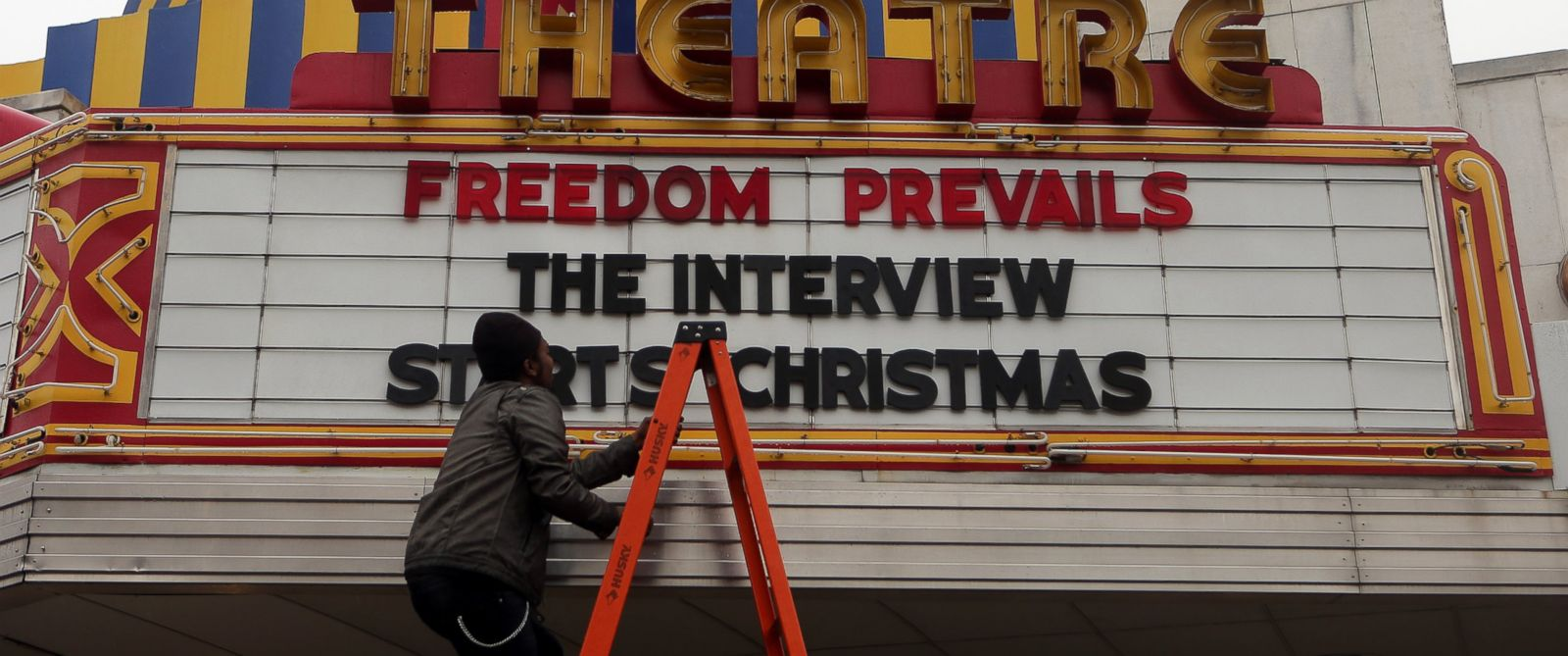 """PHOTO: Brandon Delaney, general manager of the Plaza Theatre, in Atlanta, Ga., finishes hanging the marquis Tuesday, Dec. 23, 2014 to announce that the theatre will be showing """"The Interview."""""""