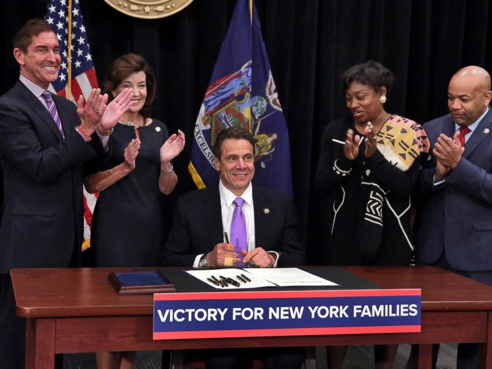 PHOTO: New York Gov. Andrew Cuomo is applauded after he signed a law that will gradually raise New Yorks minimum wage to $15 at the Javits Convention Center in New York, Monday, April 4, 2016.