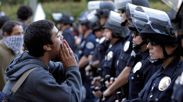PHOTO: A protester chants his slogans in front of police officers during a rally in Los Angeles on Nov. 17, 2011.