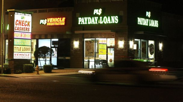 PHOTO: Neon signs illuminate a payday loan business in Phoenix, in this April 6, 2010 photo.