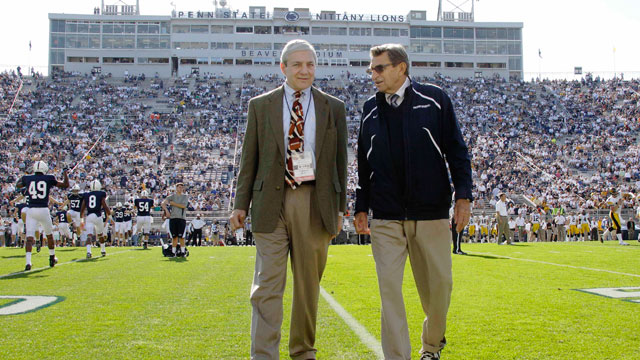 PHOTO: In this Oct. 8, 2011, file photo Penn State president Graham Spanier, left, and head football coach Joe Paterno chat before an NCAA college football game.