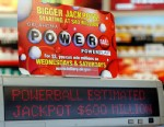 PHOTO: A sign at a store advertises the Powerball Lottery in Oklahoma City, Friday, May 17, 2013.