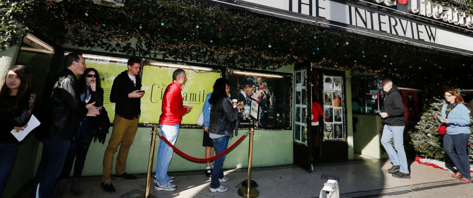 """PHOTO: Patrons queue up to see """"The Interview"""" at the the Cinefamily at Silent Movie Theater in Los Angeles on Dec. 25, 2014."""
