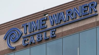 PHOTO: A logo sign outside of an office building occupied by Time Warner Cable Enterprises Inc., in Herndon, Virginia on July 5, 2015.