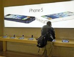 PHOTO: Advertisements for the iPhone 5 are displayed at an Apple store, Jan. 14, 2013 in New York.