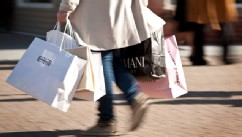 PHOTO: A shopper carries bags at the Woodbury Common Premium Outlets center in Central Valley, New York on Oct. 28, 2011.