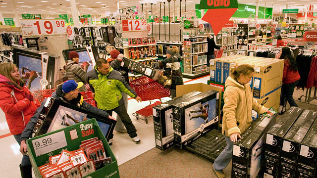 PHOTO: Shoppers grab flat screen televisions on sale immediately after the opening of a Super Target store in Thornton, Colo., Nov. 26, 2010.