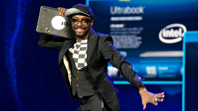 "PHOTO: Entertainer will.i.am, Intel Corp.'s director of creative innovation, makes a joke about his Ultrabook being the new ""ghetto blaster"" during an Intel Corp. presentation at the 2012 International Consumer Electronics Show (CES) in Las Vegas, Nevada,"