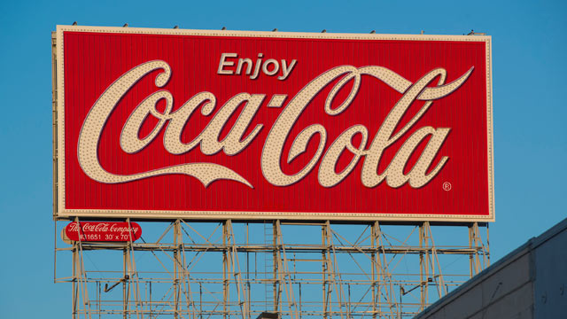 PHOTO: Coca-Cola Co signage is displayed on top of a building on Bryant Street in San Francisco, California, U.S., on Feb. 6, 2013.