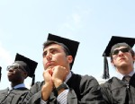 PHOTO: Boston College graduates listen to its 150th commencement, May 20, 2013, in Chestnut Hill, Mass.