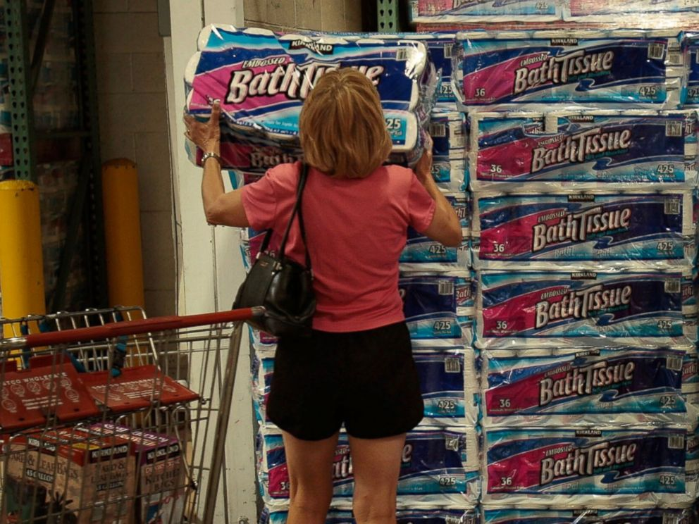 PHOTO: A shopper grabs a bulk package of toilet paper at a Costco store April 4, 2008 in Tucson, Ariz.