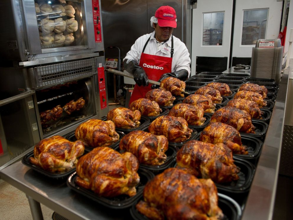 PHOTO: A service deli worker places cooked rotisserie chickens in containers at a Costco store in San Francisco, Calif. on Dec. 6, 2011.