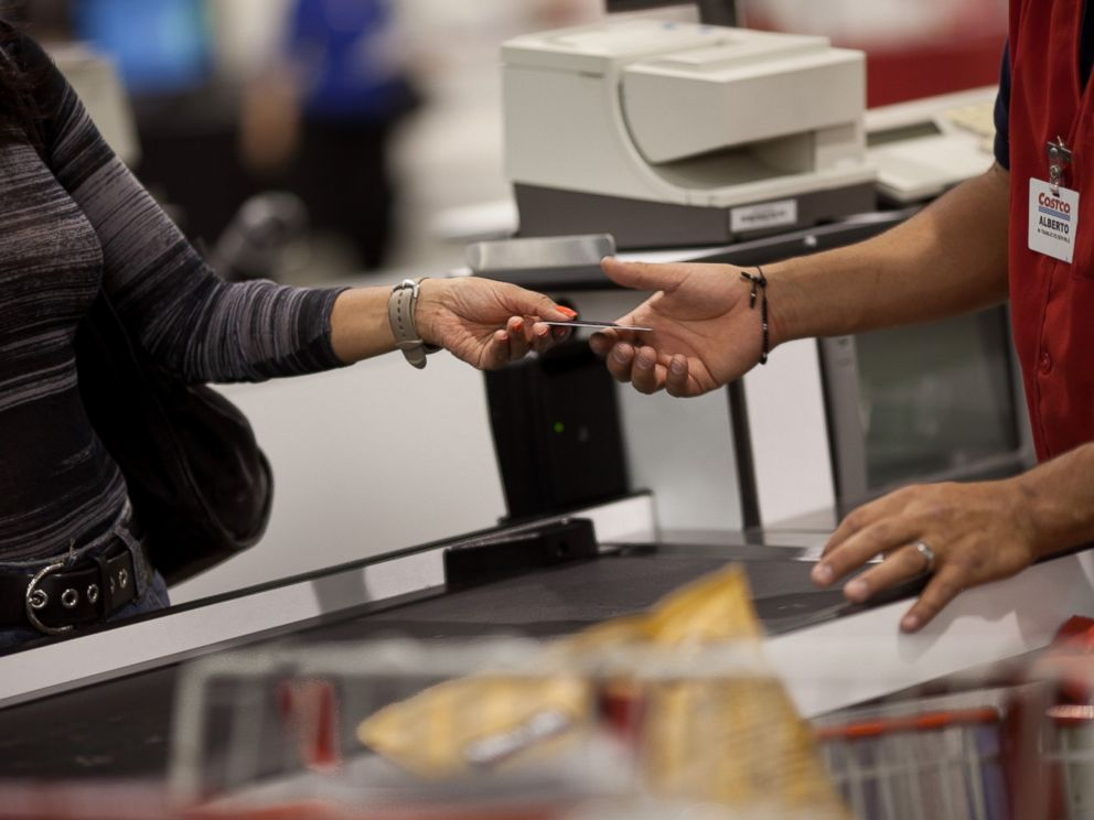 PHOTO: A customer hands the cashier her membership card to make purchases at the Costco outside of Mexico City on May 21, 2012.