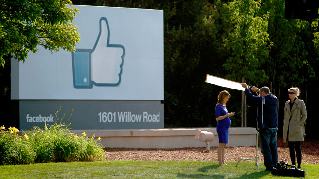 PHOTO: A television crew prepares for a broadcast in front of a like sign outside Facebook headquarters on May 18, 2012 in Menlo Park, Cali.