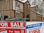 PHOTO: Signs sit on a snow-covered lawn of a home for sale in Westerville, Ohio,  Jan. 24, 2008.