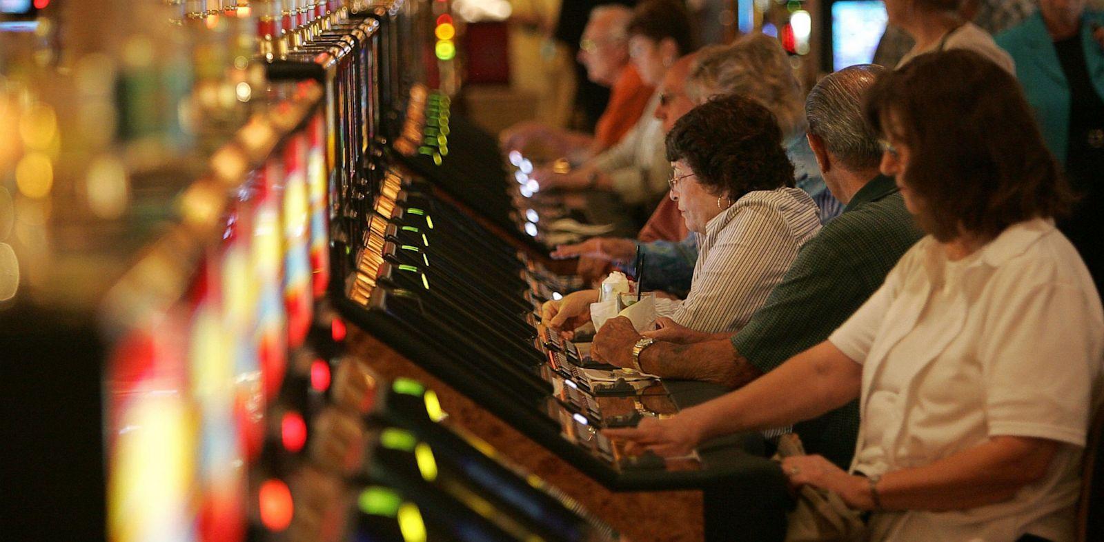 PHOTO: People playing slot machines