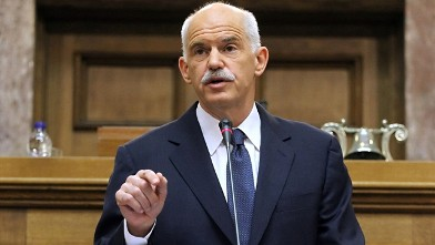 PHOTO: Greek Prime Minister George Papandreou gestures during his speech to the Panhellenic Socialist Movement (PASOK) parliamentary group at the Greek parliament in Athens, Oct. 31, 2011.
