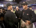 PHOTO: Head Coach Jim Harbaugh of the San Francisco 49ers embraces his brother Head Coach John Harbaugh of the Baltimore Ravens prior to the game, Nov. 24, 2011 in Baltimore.