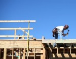 PHOTO: A construction worker uses a hammer at a new housing development, Feb. 20, 2013, in San Mateo, Calif.