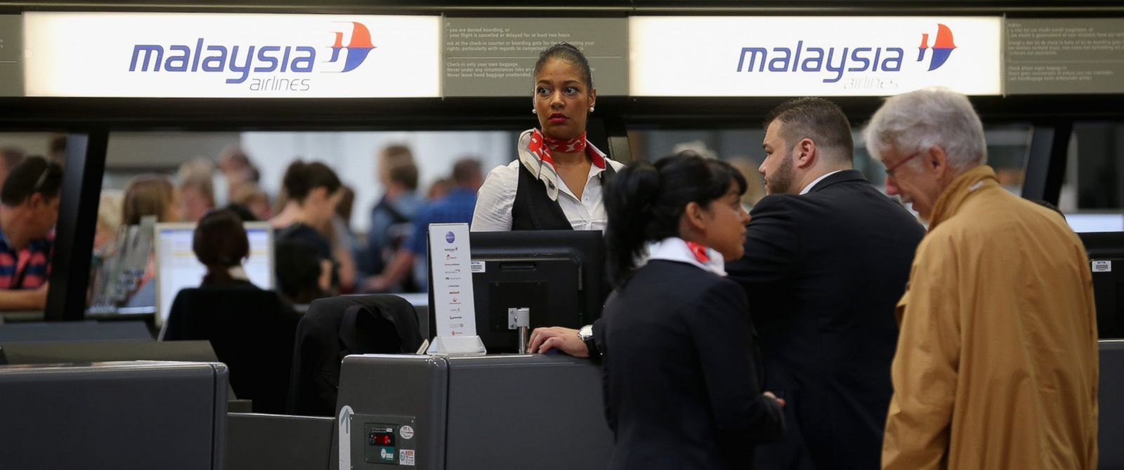 PHOTO: Passengers check in for an Air Malaysia flight at Schiphol Airport on July 18, 2014 in Amsterdam, Netherlands.