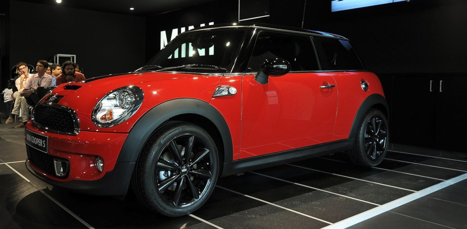 PHOTO: A new Mini Cooper S sits on display in a showroom at its launch in Mumbai on April 5, 2012.