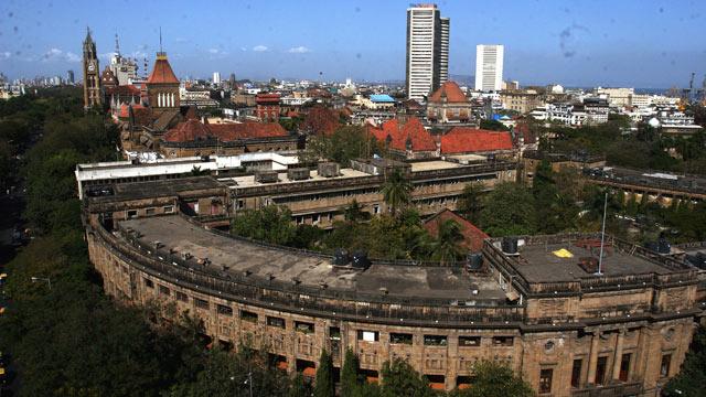 PHOTO: Aerial View of the Rajabai Clock Tower, Bombay Stock Exchange Building, Mumbai University and Mumbai City in Mumbai, Maharashtra, India.