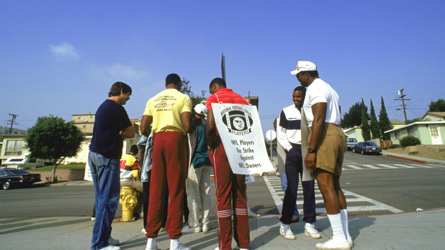 PHOTO: Members of the Los Angeles Raiders stand in a picket line during the NFL Players Union Strike in September 1987.