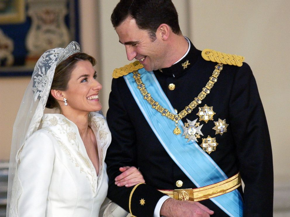 PHOTO: Crown Prince Felipe Of Spain, Prince Of The Asturias, laughing with his bride Crown Princess Letizia in the royal palace after their wedding, May 22, 2004.