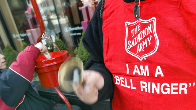 PHOTO: A donation is made as Salvation Army bell ringer Ruben Rios works outside a store on the Magnificent Mile in Chicago.