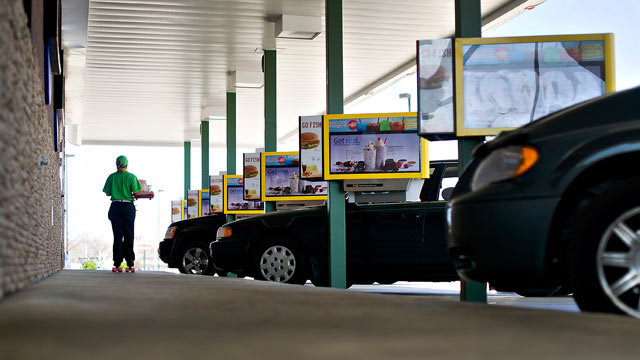 PHOTO: An employee delivers food at a Sonic Corp. drive-in restaurant in Normal, Ill., March 20, 2012.