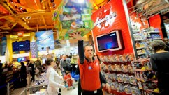 "PHOTO: An employee carries boxes at a Toy ""R"" Us Inc. store in New York, Nov. 14, 2011."