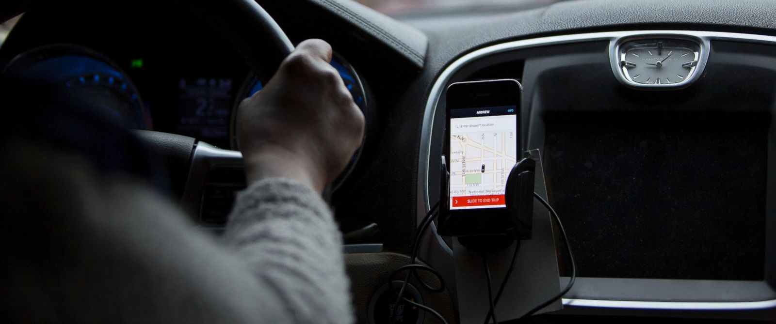 PHOTO: The Uber application runs on a drivers iPhone during an Uber ride in Washington, D.C., April 8, 2015.
