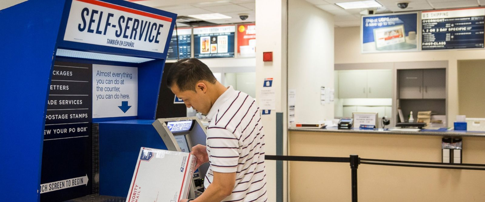 PHOTO: A man uses a self service machine at a United States Post Office (USPS) on Sept. 25, 2013 in New York City.