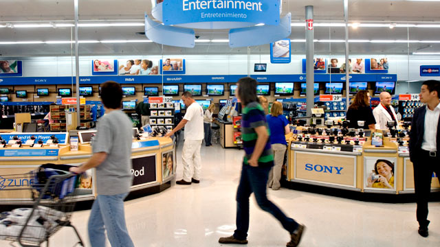 PHOTO: Shoppers walk past the entertainment and electronics section in a Wal-Mart Supercenter store, Rogers, Arkansas, March 10, 2009.