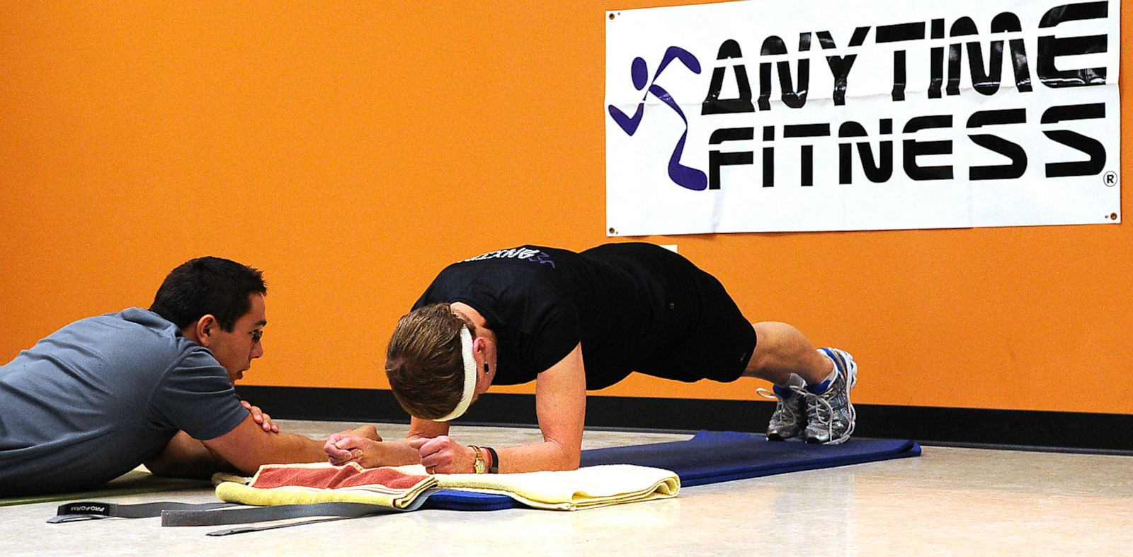 PHOTO: With her trainer, Dave Candra at her side, Betty Sweeney, 71, of Plover, Wis. unofficially breaks the Guinness World Record for holding the plank position, an abdominal exercise on September 28, 2011.