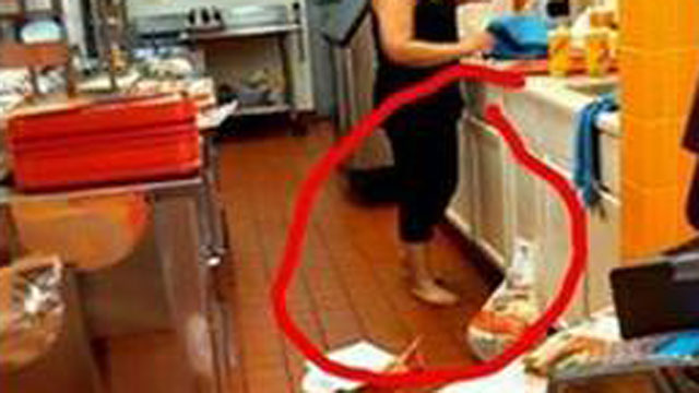 PHOTO: A photo of a barefooted Taco John's employee preparing food in Iowa has gone viral online.