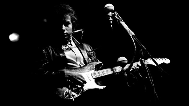 "PHOTO: Musician Bob Dylan plugged in and ""went electric"" at the 1965 Newport Folk Festival, 1965."
