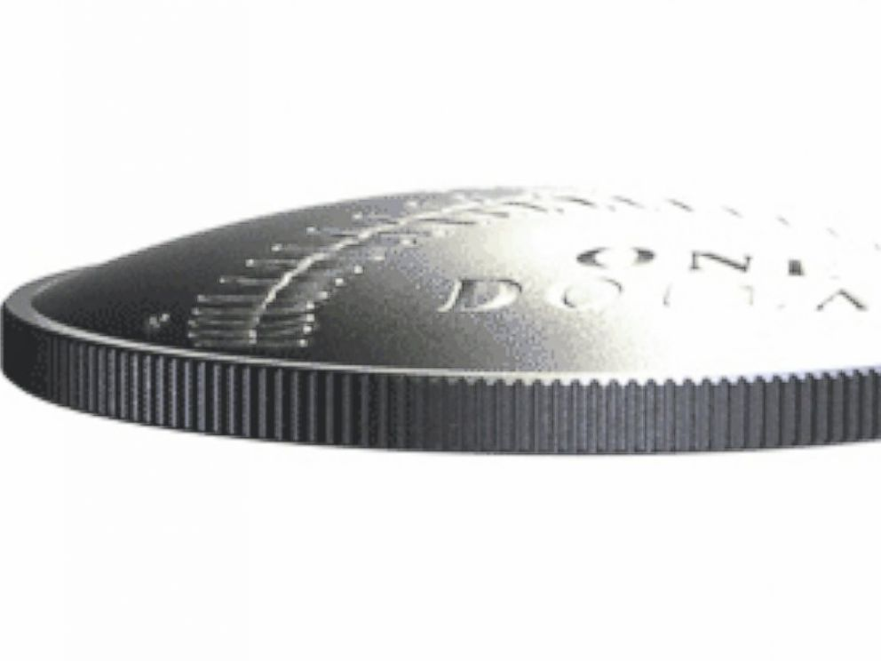 PHOTO: The first curved coin produced by the US Mint.