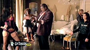 Photo: GoDaddys Lola Banned From Super Bowl: Commercial features effeminate football player designing lingerie.