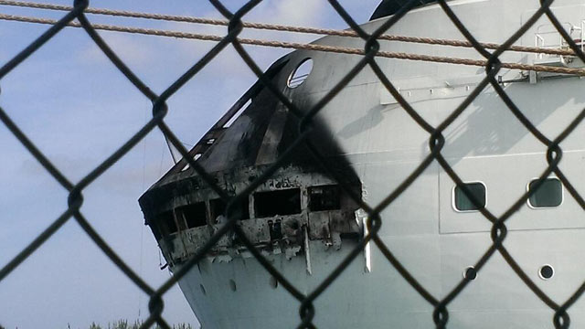 """PHOTO: This photo, posted on Twitter by Royal Caribbean Public Relations on May 27, 2013 with the caption """"damage from the Grandeur of the Seas docked in Freepoty. All guests and crew are safe and accounted for."""""""