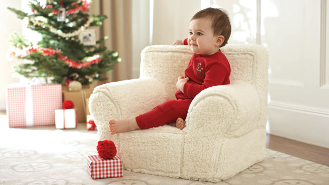 PHOTO: Red reindeer one piece jumper and my first anywhere chair Sherpa from Pottery Barn Kids.