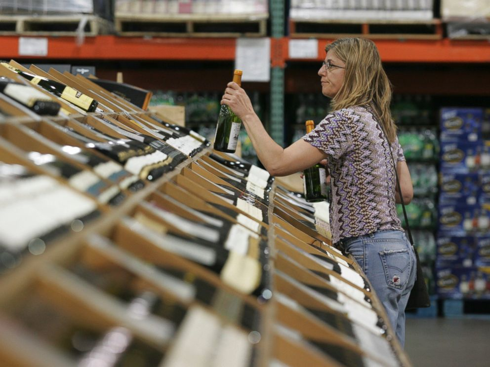 PHOTO: A shopper selects bottles of wine at the Costco Warehouse in Arlington, Va.on May 29, 2008.