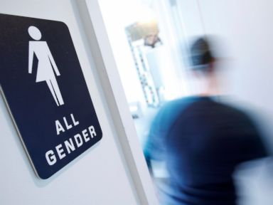 PHOTO: A bathroom sign welcomes both genders at the Cacao Cinnamon coffee shop in Durham, North Carolina, May 3, 2016.