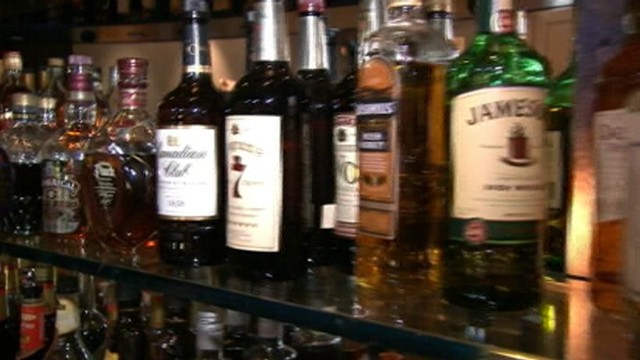 VIDEO: State investigators accuse bars, restaurants of selling cheap liquor in premium brand bottles.
